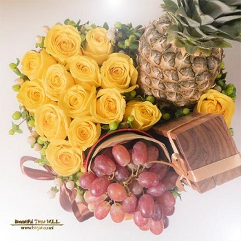 Fresh Yellow Roses, Grapes, Chocolate & Pineapple Arrangement